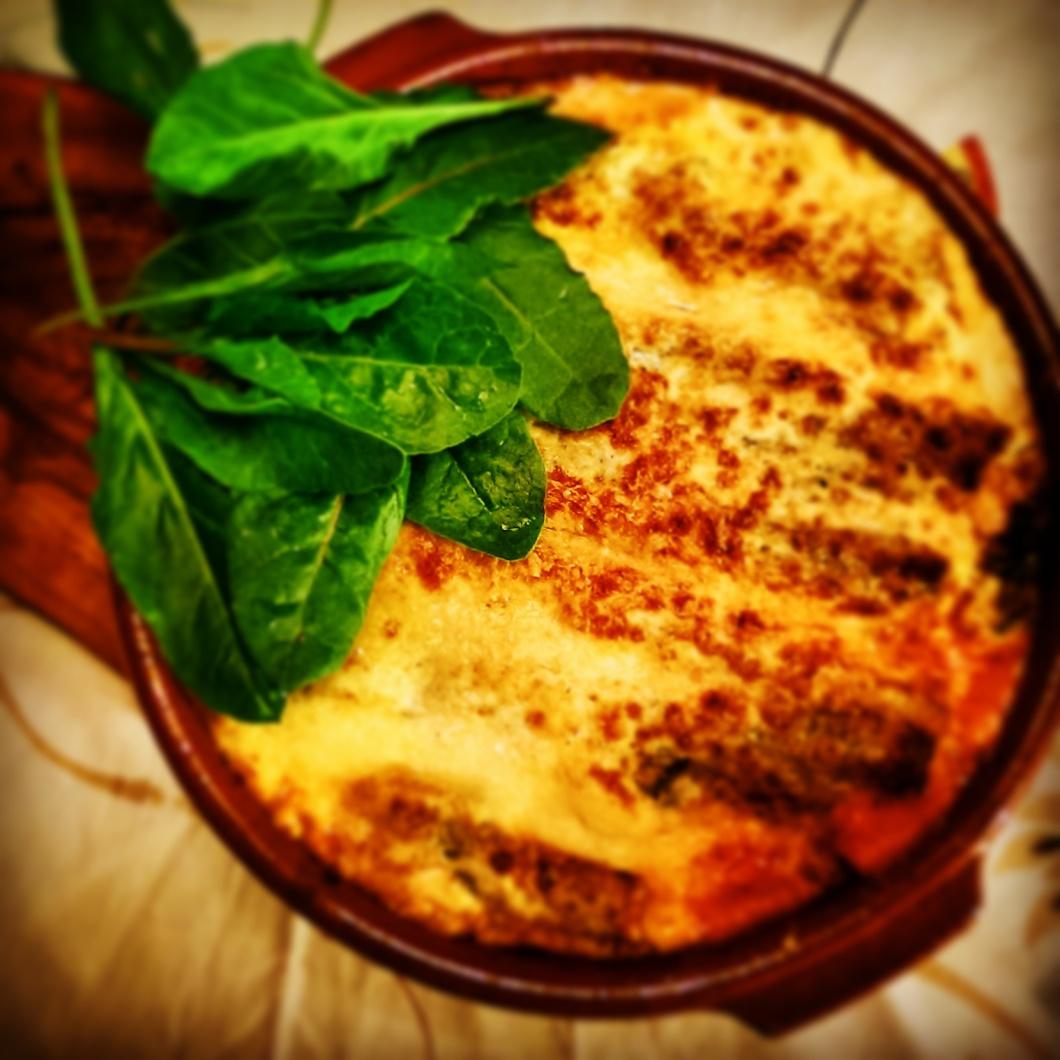 Lasagna de espinacas silvestres y bacon